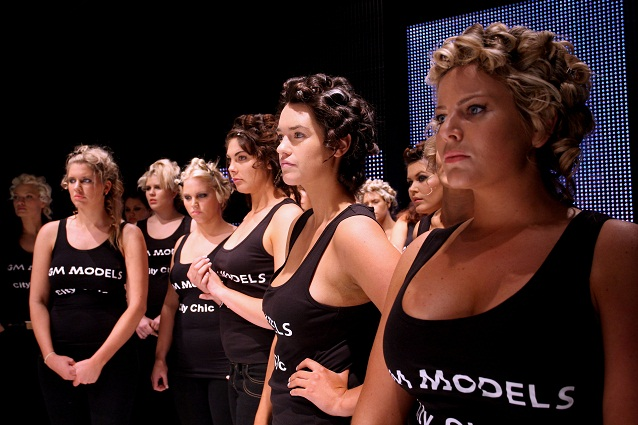 Models over size for the first time parading in London.