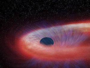 Questo buco nero ha molta fame: da 10 anni sta mangiando una stella più grande del Sole