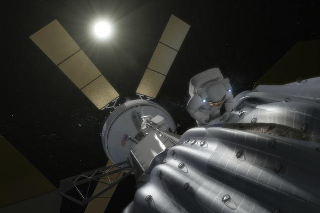 """Rappresentazione artistica di un astronauta impegnato nel raccogliere campioni dall'asteroide """"intrappolato"""" (fonte NASA)"""