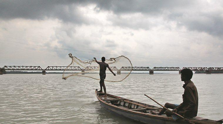Pescatori sul fiume Tista