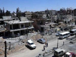 """Siria, scoperta fossa comune nell'ex capitale dell'Isis: """"Ci"""