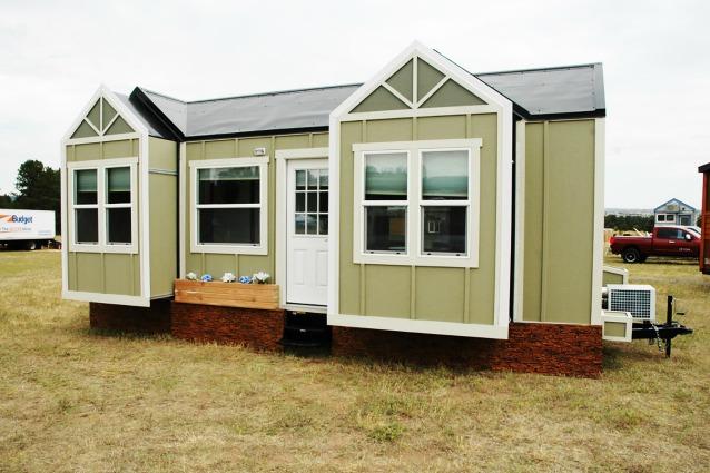Una mini casa non convenzionale basta un bottone per farla espandere - Minibar per casa ...