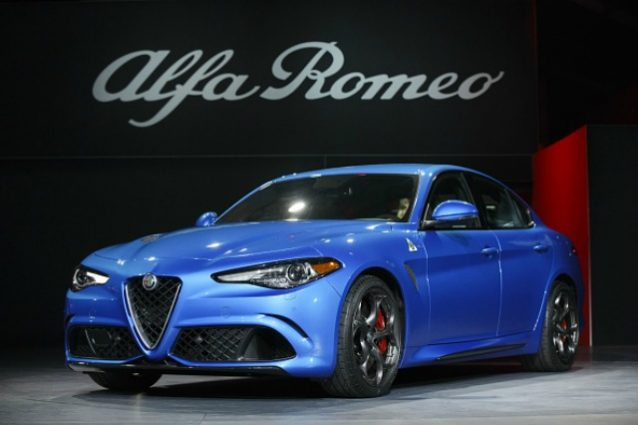 The Alfa Romeo Giulia vehicle is unveiled during Automobility LA ahead of the Los Angeles Auto Show in Los Angeles, California, U.S., on Wednesday, Nov. 16, 2016. Alfa Romeo revealed its first-ever SUV, the sleek Stelvio, while Jaguar introduced an electric I-Pace concept. Photographer: Patrick T. Fallon/Bloomberg