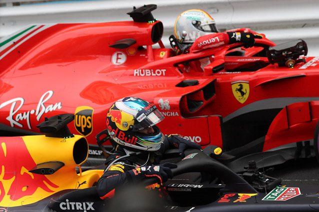 La Ferrari di Vettel insieme alla Red Bull di Ricciardo – LaPresse