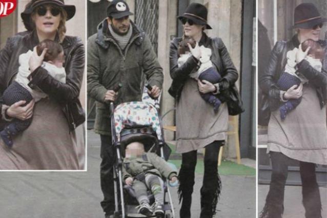 Laura Chiatti a spasso con Marco Bocci a due mesi dal parto: le foto del pancione