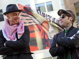 Fedez e J-Ax contro un locale di Milano: 100mila euro di danni per un fotomontaggio