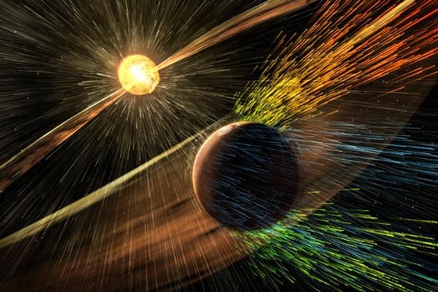 Rappresentazione artistica di una tempesta solare che colpisce Marte (Credits: NASA/GSFC)