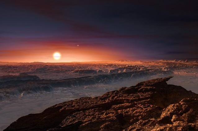 Rappresentazione artistica mostra una veduta della superficie del pianeta Proxima b in orbita intorno alla nana rossa Proxima Centauri, la stella più vicina al Sistema Solare (Crediti:ESO/M. Kornmesser)