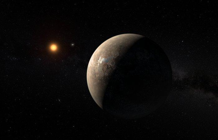 Rappresentazione artistica dell'esopianeta Proxima b in orbita intorno alla stella nana rossa Proxima Centauri. La stella doppia Alfa Centauri AB appare nell'immagine in alto a destra di Proxima. (Crediti: ESO/M. Kornmesser)