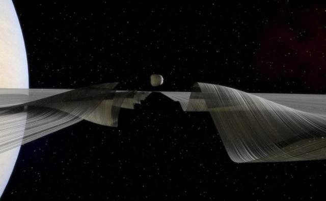 Il passaggio di Dafni genere il moto ondoso sull'Anello A di Saturno - Illustrazione di Kevin Gill NASA/JPL